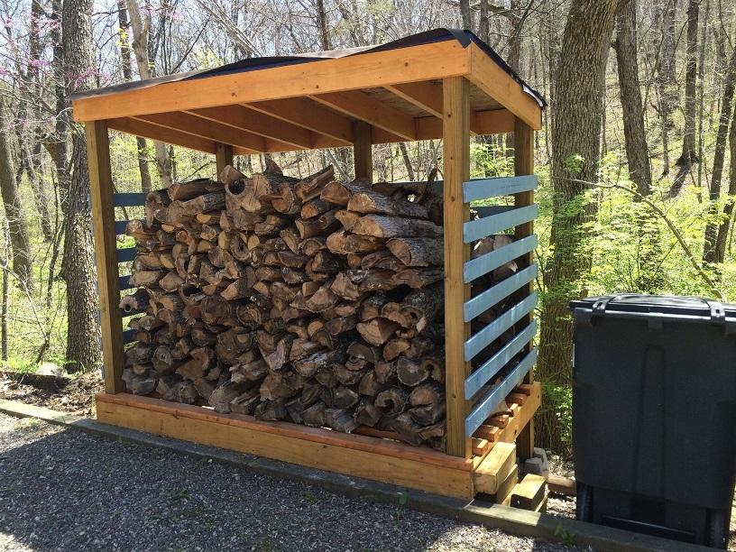 Left Side Wood Shed Full of Wood